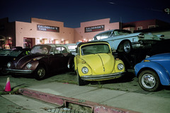 (patrickjoust) Tags: monterey california vw old cars vehicles dealer parked night fujicagw690 kodakportra160 6x9 medium format 120 fuji rangefinder 90mm f35 fujinon lens c41 color negative film manual focus analog mechanical patrick joust patrickjoust usa us united states north america estados unidos cable release tripod long exposure after dark car auto automobile vehicle dealership