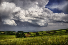 Passing Storm (Dimmilan) Tags: serbia rajac landscape nature hills fields grass sky clouds storm sunshine weather countryside