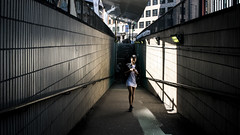 Tunnel Vision 68/156 (markfly1) Tags: street candid light shade dark leading lines woman walking detached girl straight horizontal vertical london underpass tunnel colour colourful 35mm manual focus nikon d750