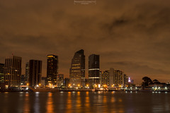 Entering the night (Mariano Colombotto) Tags: buenosaires argentina city cityscape skyline skyscrapers buildings edificios ciudad night noche nocturnal nocturna nikon photographer photography travel clouds nubes river rio lights luces autofocus infinitexposure