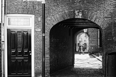 214 (Alfred Grupstra) Tags: blackandwhite architecture old history oldfashioned door cultures buildingexterior antique builtstructure famousplace urbanscene entrance retrostyled arch house victorianstyle europe