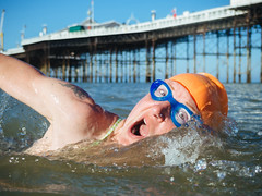 Sarah of Brighton Swimming Club (lomokev) Tags: swimming swimmingclub brighton brightonpier palacepier people pier portrait postedtoflickr sea sport action olympusomdem5 olympus omd em5 olympusomd wildswimming