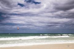 Orange kite (Monika Kalczuga (on&off)) Tags: kite kitesurfing clouds ocean fuerteventura canaryislands vacation holidays summer seascape beach sand shoreline coastline nature water coast spain island