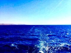 Aqaba, Jordan (WorldExplorations) Tags: peninsula arabian sinai sinaipeninsula middleeast jordan shoreline shore coastline coast landscape sky blue waves water sea redsea gulf gulfofaqaba aqaba
