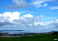 Looking North Past Orkney's Kirkwall Town (orquil) Tags: north elevated view northerly outlook overlooking kirkwall town royalburgh seaside seascape kirkwallbay blue sea notable landmark silhouette ancient stmagnus norse cathedral spire numerous houses buildings foreground rural mainlandorkney farmland fields distant northisles including left rousayisland huge mixed bluesky skyscape cloudscape many puffy white cumulus clouds sunny june morning summer sunshine orkney islands scotland uk unitedkingdom greatbritain britain orcades attractive interesting scenic beautiful memorable scapes landscape panorama