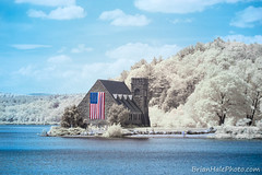 Old Stone Church in Halespectrum (Brian M Hale) Tags: old stone church halespectrum infrared ir infra red american flag usa new england newengland ma mass massachusetts wachusett reservoir w boylston west outside outdoors 6d lifepixel modified full spectrum fullspectrum filters brianhalephoto brian hale color false different unique water lake pond nature trees architecture sky clouds canon