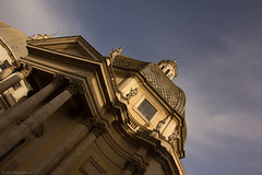 Golden Angles (Anthony P26) Tags: architecture category external italy piazzadelpopolo places rome travel architecturephotography travelphotography dome columns capital sunlight sunset sunglow goldenlight goldenhour canon canon1585mm chiesadisantamariadeimiracoli church placeofworship windows sky bluesky whispyclouds whiteclouds clouds canon550d statue scuplture