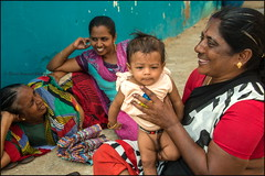 Baby.  Kanyakumari (Claire Pismont) Tags: asia asie inde india pismont clairepismont colorful couleur color colour child baby boy travel travelphotography tamilnadu kanyakumari streetshot street streetphotography woman women
