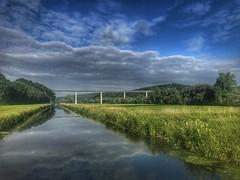 Neckartal (Blende2,8) Tags: reutlingen badenwürttemberg deutschland wiesen wolken himmel brücke kanal wasser wald
