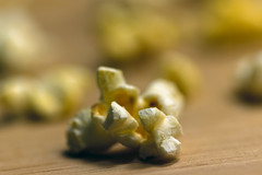 Popped (DaveLawler) Tags: popcorn popped corn kernel wood board snack yellow butter macro dof