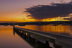Rain on the horizon (Sterling67) Tags: sunset postsunset clouds rain lakemacquarie bolton point water reflection 2470