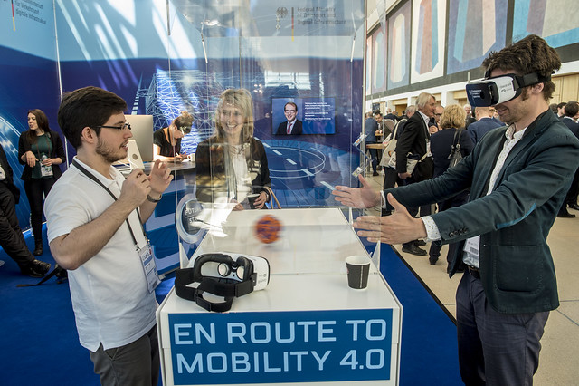 Visitors explore new technologies at the Germany ministry stand