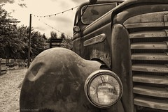 In the farmyard.... (Joe Hengel) Tags: inthefarmyard farmyard truck oldtruck headlights grill lightpost california ca clouds cloudy sepia bw blackandwhite monochrome goldenstate temecula socal southerncalifornia 7dwf 7dayswithflickr riverside county
