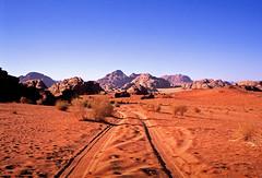 (louis de champs) Tags: minoltasrt101 film agfaprecisa100 vividcolors desert redsand mountains wadirum jordan pickup tracks