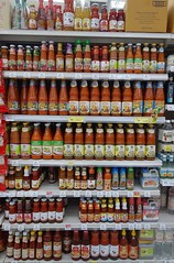 hot sauces (the foreign photographer - ฝรั่งถ่) Tags: hot sauces bottles tesco lotus supermarket laksi bangkhen bangkok thailand sony rx100