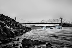 On the rocks (FerTravelPhoto) Tags: bw beach black blackandwhite blue bridge commons d750 hills iceberg iceland landscape longexposure monochrome mountain nikon outdoor river rocks selectivecoloring shore snow travel water winter