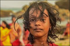 Wind.  Kanyakumari (Claire Pismont) Tags: rouge asie asia inde india indedusud travel travelphotography tamilnadu travelshot streetphotography pismont clairepismont colorful couleur color colour child girl portrait pilgrim windy documentory hinduism hindouisme