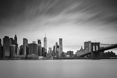 Manhattan ([~Bryan~]) Tags: manhattan lowermanhattan daytimelongexposure brooklynbridge brooklyn wtc building newyork city urbanlandscape skyscraper cityscape urban cityskyline newyorkcity nyc bw monochrome blackandwhite
