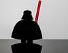 Vader (jeff's pixels) Tags: macromondays silhouette macro monday lego minifigure starwars darthvader darth toy fun lightsaber reflection
