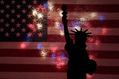 Mother Of Exiles (amarilloladi) Tags: starsandstripes flag redwhiteandblue motherofexiles america ellisisland statueofliberty 7dwf macromondays silhouette