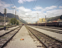 Jesenice, Slovenia. (wojszyca) Tags: wanderlust travelwide 90 4x5 largeformat schneiderkreuznach angulon 90mm gossen lunaprosbc expired kodak portra 160nc epson v800 railroad railway jesenice slovenia alps urban landscape mountains tracks