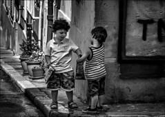 Tu m'en donnes un peu? /   You give me a little bit? (vedebe) Tags: noiretblanc netb nb bw monochrome enfant people humain rue street urbain ville city