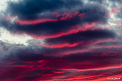 away from our window (blacqbook) Tags: clouds sky ominous colorful sunset sundown beauty red dark fiery intense twilight angry abstract nature mysterious tumultuous lookingup weather gray evening white blue horizontal streaks background blacqbook toronto