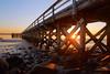 Over the Sea (SunnyDazzled) Tags: fortfoster maine coast ocean sea rocks pier wooden rails horizon sunset sunbeams sand kittery beach