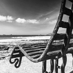 Baywatch (Bruus UK) Tags: constantine bay seat bench rust old baywatch atlantic beach coast marine padstow cornwall view weathered sky clouds seascape landscape brigt sunlight dof rest