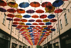 umbrellas into the distance (georgerebello1) Tags: leica flex leicaflex 35mm lens analog bath city street people buskers music light perspective