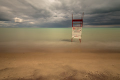no lifeguard on duty (Marc McDermott) Tags: lakeontario water beach sand sky dramatic dark clouds longexposure canada beautiful lifeguard chair high level ontario canon ef 1635mm f4 is usm neutraldensity 10stop