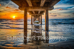 Sunrise Under the Pier (tod grubbs) Tags: caldwellpier texascoast coastal sunrise seascape fishingpier texasbeach texascoastallandscape beachocean coast surf waves beach landscape landscapes water colorfulsunrise seaweed gulfofmexico sand nature shore scenic portaransas porta