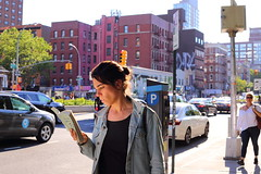 Multitasking (Deliberate Spoonerism) Tags: person girl woman city new york nyc manhattan lez les lower east side street book reading walking traffic light shadow hair eyes bun portrait jacket blue golden hour color sunset backlight backlit dusk evening sign car cars signs graffiti architecture buildings building glasses colors bokeh dof canon 5dmarkiii mk3 mark3 mkiii 50mm f18 stm ef unitedstates contrast