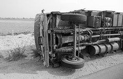 Tipped Truck (peterkelly) Tags: bw digital canon 6d india asia jaipur rajasthan truck tipped knockedover accident road street undercarriage wheels