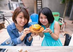 Smiling girls and doughnut (Apricot Cafe) Tags: img36843 2024years 2529years asia asianandindianethnicities cafe japan japaneseethnicity shibuyaward sigma20mmf14dghsmart tokyojapan beautifulwoman blackhair brownhair buildingexterior candid carefree casualclothing charming cheerful citylife colorimage communication connection day doughnut enjoyment foodanddrink friendship happiness holding leisureactivity lifestyles lookingatcamera lunch onlyjapanese onlywomen onlyyoungwomen outdoors people photography restaurant shopping smiling snack togetherness toothysmile twopeople women youngadult