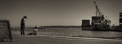 Quayside chit-chat (Blue Rock Fox) Tags: poole dorset dock harbour port ocean sea water coast icecream crane brownseaisland boats jetty men summer cargo blackandwhite mono documentary astrastjohns davidbellis davidmichaelbellis bluerockfox bluerockfoxproductions canon canon5diii canon5d111 canon5d3