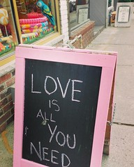 L❤ve is all you need 💖💜💙💟 And a cute #parrot 😉 #chalkboard #lovenoteforall #positivevibes #collegestreet #storefront  Happy Friday everyone! 💕😀 (Georgie_grrl) Tags: instagramapp square squareformat iphoneography uploaded:by=instagram mayfair chalkboard love positive collegestreet sign message storefront parrot toronto ontario