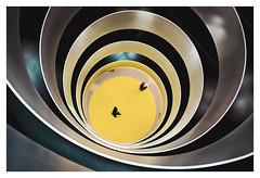 Vertigo - in explore (Dave Fieldhouse Photography) Tags: modernism modern round circles circle abstract vertigo yellow architecture buildings balcony birmingham people street streetphotography urban colour chrome down height business fujixpro2 fujinon35mmf2 fuji fujifilm project uk england handheld wwwdavefieldhousephotographycom interior indoors levels concentric perspective depth falling