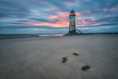 Leaning, towards a lie in. (Pete Rowbottom, Wigan, UK) Tags: sunrise dawn beach sea water sky pink red blue light lighthouse talacre pointofayr wales northwales sand sandybeach earlymorning firstlight wideangle clouds cloudscape longexposure longexposurelandscape peterowbottom seaweed nikond750 landscape uk uklandscape ukcoast ukcoastline ukbeaches welsh cymru golden colorful contrast sun glow dramatic movement dramaticsky detail waterreflections pinksky redsky prestatyn slowshutter leefilters greatbritain outdoor dreamy