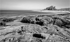 Banburgh . (wayman2011) Tags: fujifilmxt10 lightroom wayman2011 bw mono coast seascapes seaside beach castles historicbuildings longexposures bw110 rocks northumberland bamburgh uk
