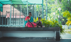 Smiles (relishedmonkey) Tags: nikon d5300 smiles kid grandmother trees outdoor nature cool chill love sunny day yellow 35mm 18g green person women woman family together seated sitting india