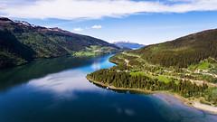 Fra Fineidfjord mot Rana (Ratatosken) Tags: norge norway helgeland fineidfjord mountaions fjord fjords summer spring green grass blue sky light clouds
