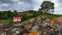 Love from the rocks ...... (Einir Wyn Leigh) Tags: landscape seascape rocks rugged cottage red house history natural foliage leaf trees green beach coast scotland scottishhighlands summer june happy favourite place colous coastal outside isle clouds heaven solace tranquility