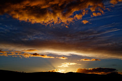 Over the hill. (alan.irons) Tags: sunset hill silhouette angus scottish clouds fire rays sunlight beams lsky canon irons blue oranges