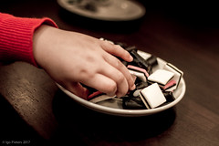 sweets (soundmoods) Tags: hand candy sweets drop child grabbing canon kid 60d 28mm18