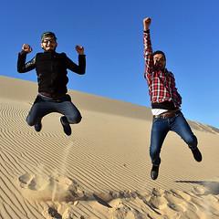 Dune Jump (__ Sascha Grabow __) Tags: jump outdoor outdoors dune sahara sand algeria algerie algerien men boys fun sprung dünen sanddünen hocke hochsprung highjump people exercise saschagrabow africa freedom spirit bluesky diagonal afrique maghreb maghrib desert fussspuren fusspuren