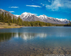 Johnson Lake (westrock-bob) Tags: landscape peaceful nationalpark mountains cuthill canon shallow reflection rocks bluesky 6d summer trees copyright stillness johnsonlake serenity alberta water outdoors canada eos banff lake mountain