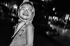 Cute little girl (B&W version) (-clicking-) Tags: streetphotography streetlife streetportrait children childhood childish childlike vietnamesechildren innocence innocent emotion happiness blackandwhite blackwhite nocolors monochrome monotone bw saigon vietnam portrait faces life dailylife night nightshot