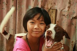 pretty girl with yawning dog