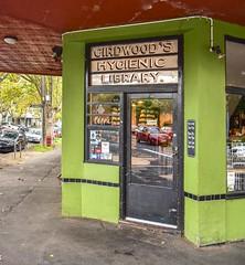 Flemington VIC (phunnyfotos) Tags: phunnyfotos australia victoria vic melbourne suburb suburban suburbia flemington newmarket shop shopfront sign girdwoodshygieniclibrary library hygieniclibrary cafe green tiles tiled verandah veranda footpath sidewalk pavement nikon pepper